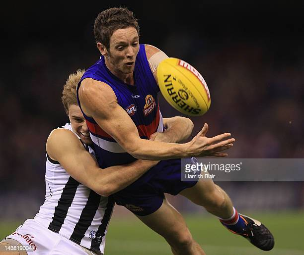 Robert Murphy of the Bulldogs is tackled by Ben Sinclair of the Magpies during the round six AFL match between the Western Bulldogs and the...