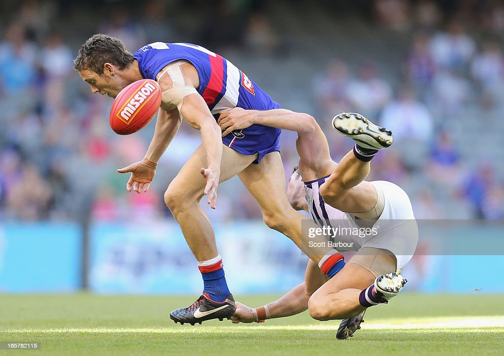 Robert Murphy of the Bulldogs is tackled during the round two AFL match between the Western Bulldogs and the Fremantle Dockers at Etihad Stadium on April 6, 2013 in Melbourne, Australia.