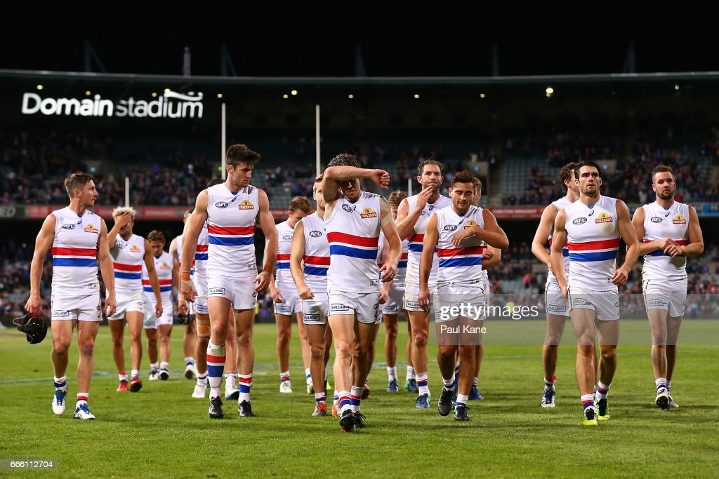 Robert Murphy of the Bulldogs leads his team from the field after being defeated during the round three AFL match between the Fremantle Dockers and the Western Bulldogs at Domain Stadium on April 8, 2017 in Perth, Australia.