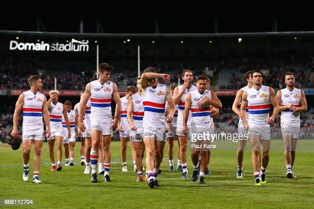 Robert Murphy of the Bulldogs leads his team from the field after being defeated during the round three AFL match between the Fremantle Dockers and...