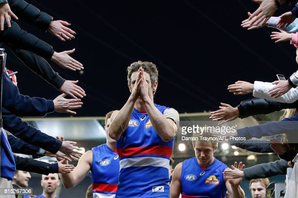 Robert Murphy of the Bulldogs leads his team off the ground after the round 17 AFL match between the Carlton Blues and the Western Bulldogs at...