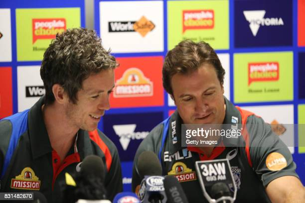 Robert Murphy of the Western Bulldogs and coach Luke Beveridge talk to the media following the announcement that Murphy will retire from AFL during a...
