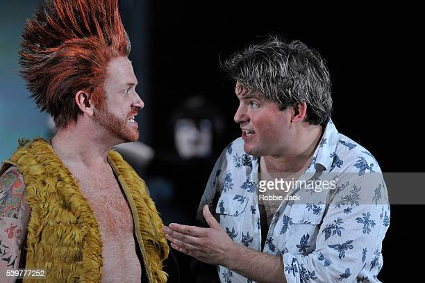 Robert Murray as Tamino and William Berger as Papageno in Garsington Opera's production of Wolfgang Amadeus Mozart's The Magic Flute directed by...