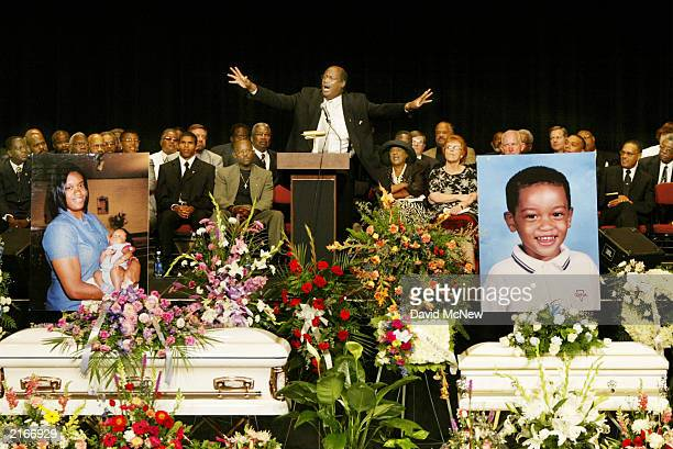 Robert N Harper a Houston Texas minister speaks at the funeral for five of his family members who were found shot to death in their home last week...
