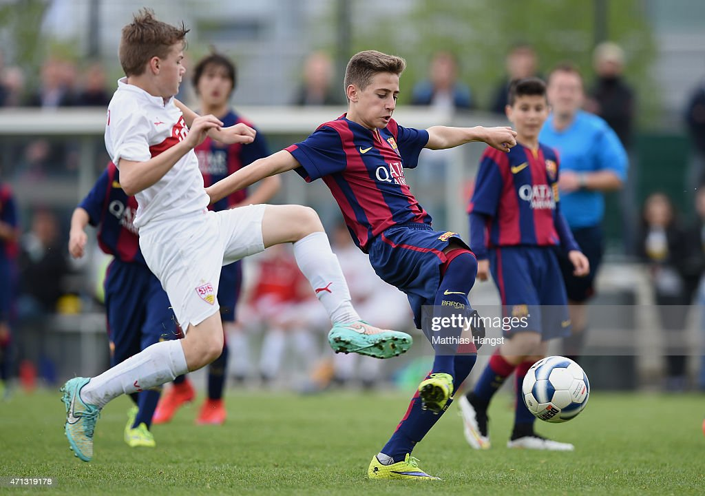 Robert Navarro Munoz (R) of Barcelona in action during the Final of the Santander Cup for U13 teams between FC Barcelona and VfB Stuttgart at Borussia Park Fohlenplatz on April 26, 2015 in Moenchengladbach, Germany.
