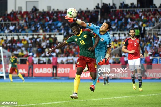 Robert Ndip Tambe of Cameroon and Essam Kamal Tawfik Elhadary of Egypt during the African Nations Cup Final match between Cameroon and Egypt at Stade...