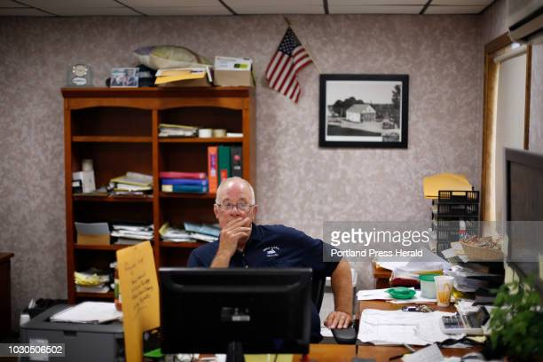 Robert Newcomb owner of Swan Lake Grocery listensin his office during a visit from gubernatorial candidate Shawn Moody in Swanville on August 3 2018
