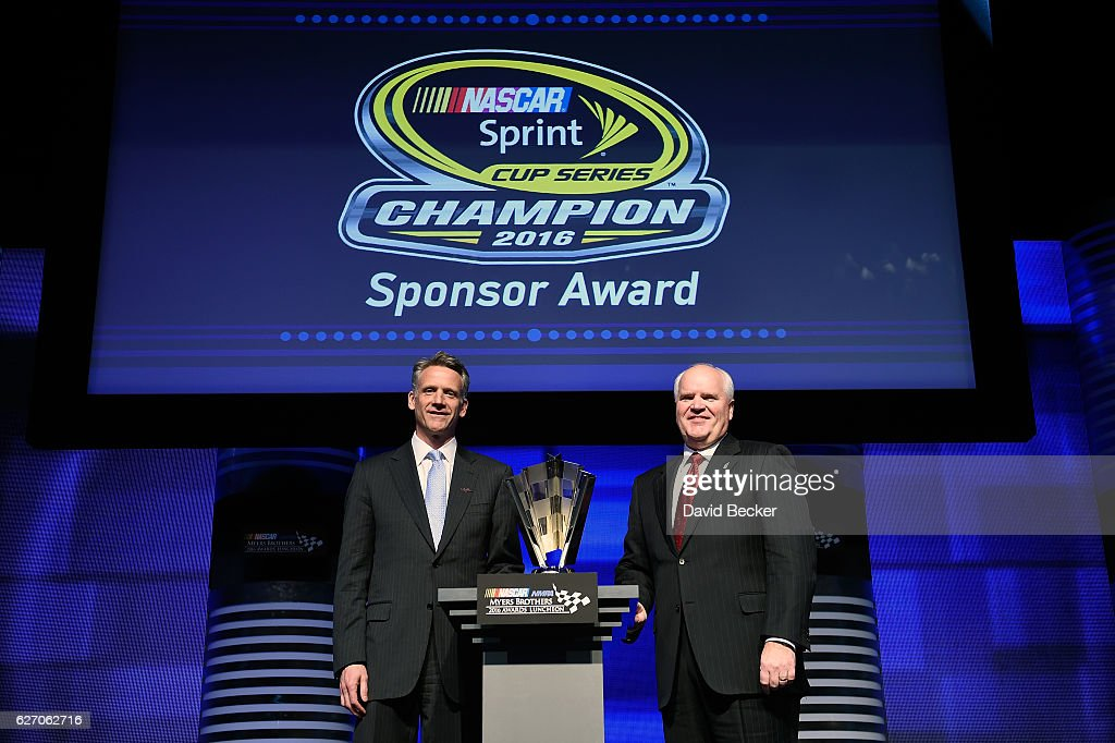 Robert Niblock(right), Chief Executive Officer for Lowes, and Steve Phelps, NASCAR Executive Vice President and Chief Global Sales and Marketing Officer, pose with the Champion Sponsor Award during the NASCAR NMPA Myers Brothers Awards Luncheon at The Wynn on December 1, 2016 in Las Vegas, Nevada.