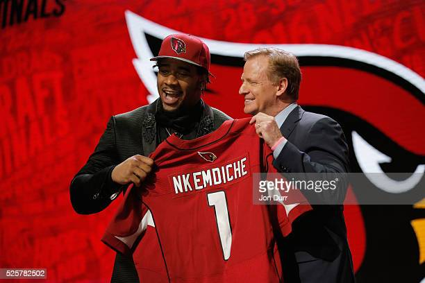 Robert Nkemdiche of Ole Miss holds up a jersey with NFL Commissioner Roger Goodell after being picked overall by the Arizona Cardinalsduring the...