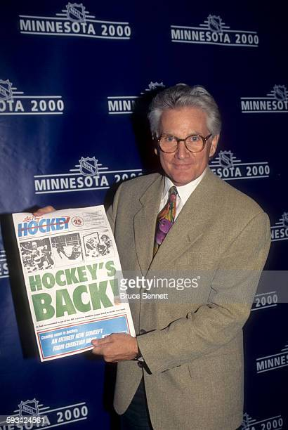 Robert O Naegele Jr owner of the Minnesota Wild holds a newspaper that shows hockey will be back in Minnesota in the year 2000 after the NHL...