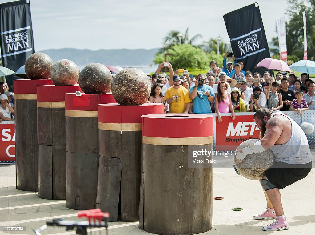 Robert Oberst of USA competes at the Atlas Stones event during the World's Strongest Man competition at Yalong Bay Cultural Square on August 24, 2013 in Hainan Island, China.
