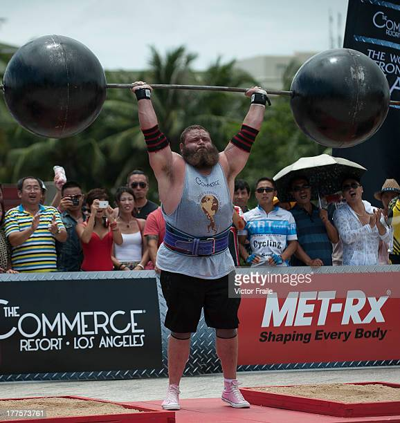 Robert Oberst of USA competes at the Circus Medley event during the World's Strongest Man competition at Yalong Bay Cultural Square on August 24 2013...