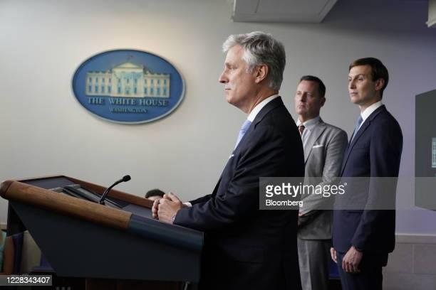 Robert OBrien national security adviser left speaks while Jared Kushner senior White House adviser right and Richard Grenell adviser to US President...