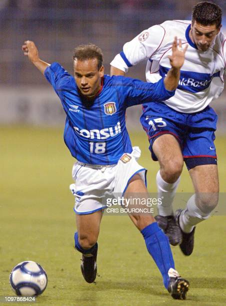 Robert of the Sao Caetano team gets the ball from chilean Mauricio Segovia of Universidad Catolica during their game in Santiago Chile 25 April 2002...