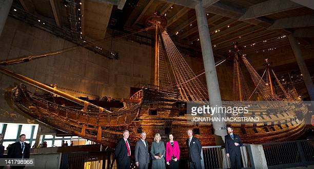 Robert Olsson, Director of the National Martime Museums in Sweden, Britain's Prince Charles and his wife, Camilla, Sweden's King Carl XVI Gustaf and...