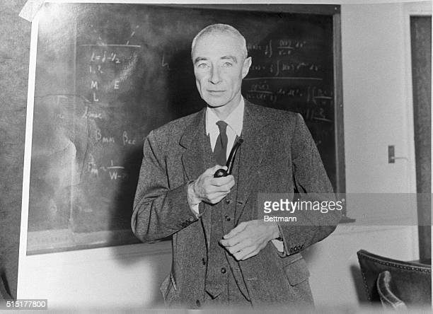 Robert Oppenheimer American physicist Director of the Manhattan project Undated photograph standing before blackboard holding pipe
