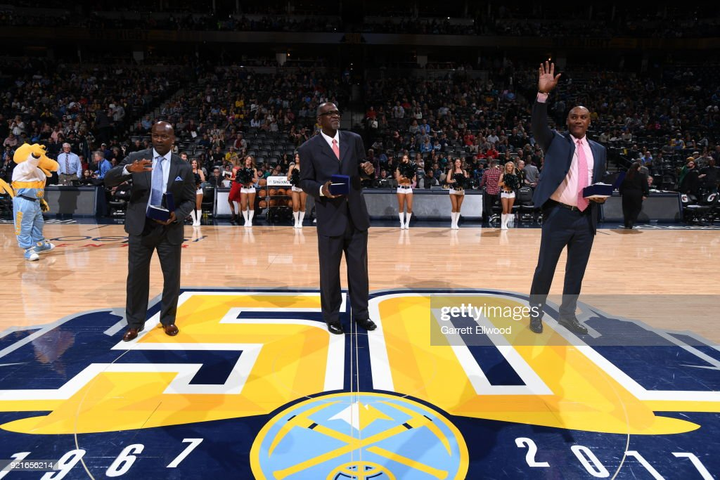 Robert Pack, Reggie Williams, and Tom Hammonds are celebrated during 90's night during the game between the Denver Nuggets and the Dallas Mavericks on January 27, 2018 at the Pepsi Center in Denver, Colorado.