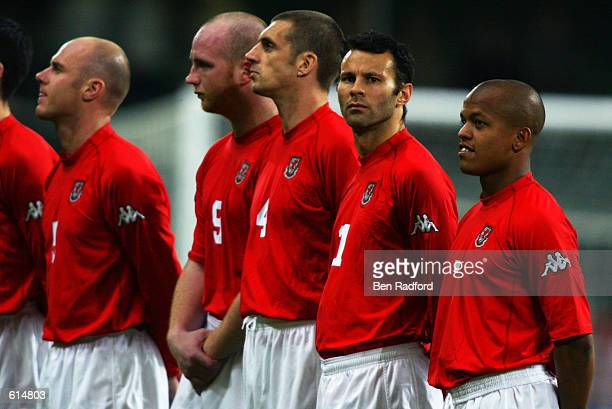 Robert Page John Hartson Andy Melville Ryan Giggs and Robert Earnshaw of Wales line up for the national anthems before the International Friendly...