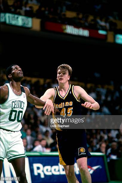 Robert Parish of the Boston Celtics and Rik Smits of the Indiana Pacers battle for position during a game played at the Boston Garden in Boston...