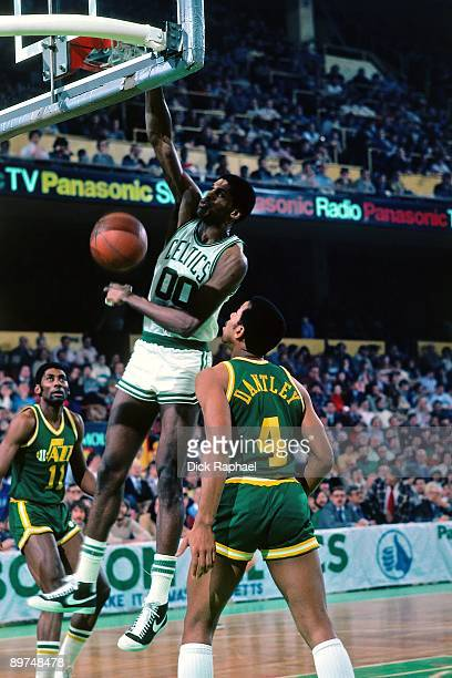 Robert Parish of the Boston Celtics dunks against Adrian Dantley of the Utah Jazz during a game played in 1982 at the Boston Garden in Boston...