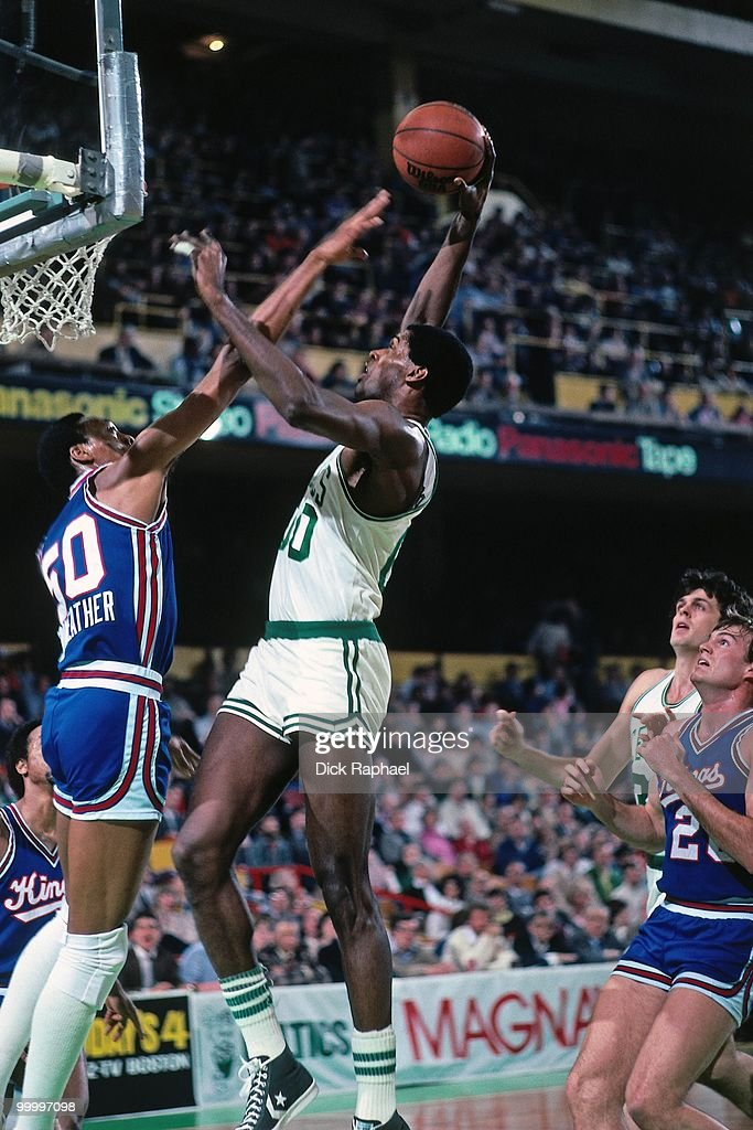 Robert Parish #00 of the Boston Celtics goes up for a shot against Joe Meriweather #50 of the Kansas City Kings during a game played in 1983 at the Boston Garden in Boston, Massachusetts.