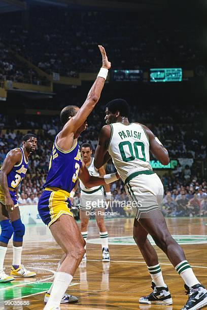 Robert Parish of the Boston Celtics makes a move against Kareem AbdulJabbar of the Los Angeles Lakers during the 1987 NBA Finals at the Boston Garden...