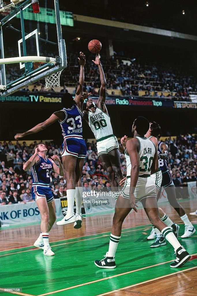Robert Parish #00 of the Boston Celtics shoots a layup against Steve Johnson #33 of the New Jersey Nets during a game played in 1983 at the Boston Garden in Boston, Massachusetts.