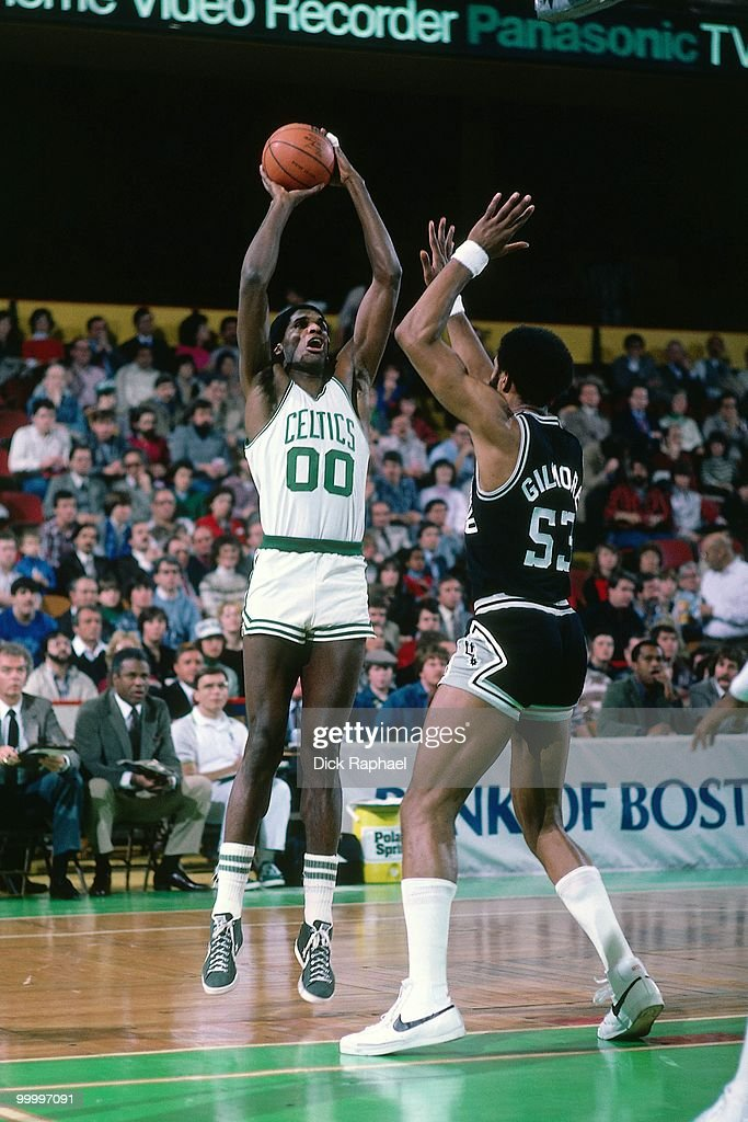 Robert Parish #00 of the Boston Celtics shoots against Artis Gilmore #53 of the San Antonio Spurs during a game played in 1983 at the Boston Garden in Boston, Massachusetts.