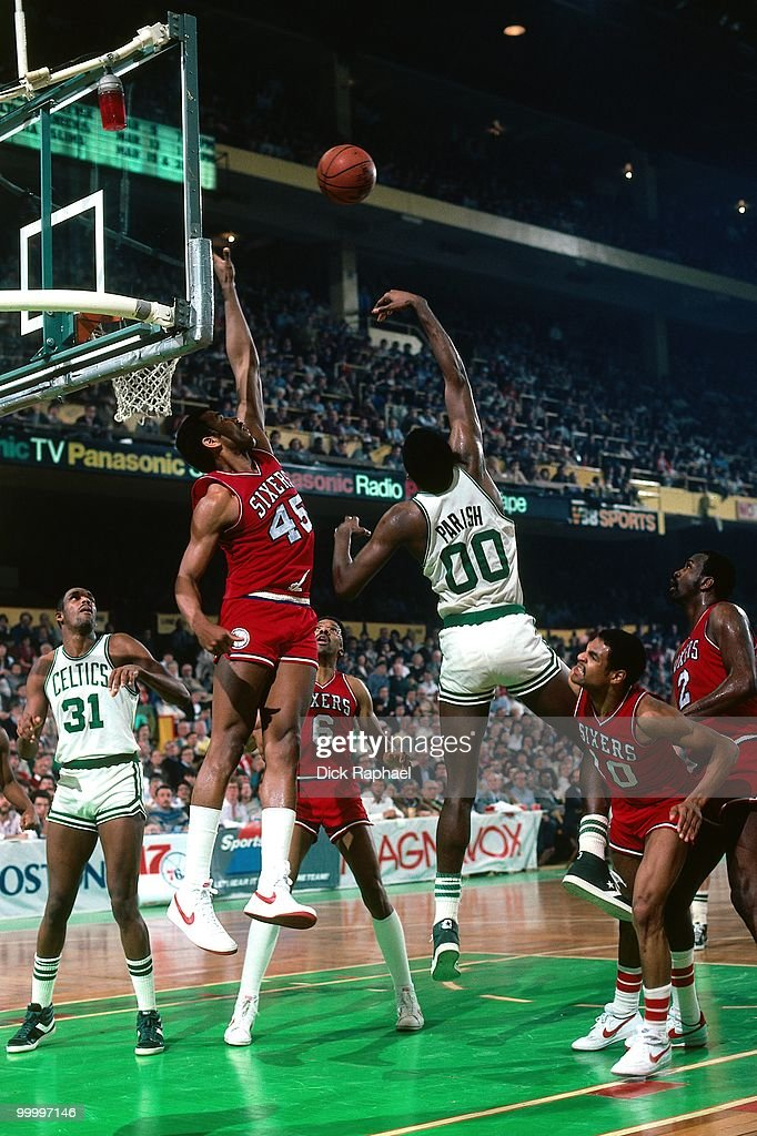 Robert Parish #00 of the Boston Celtics shoots against Clemon Johnson #45 of the Philadelphia 76ers during a game played in 1983 at the Boston Garden in Boston, Massachusetts.