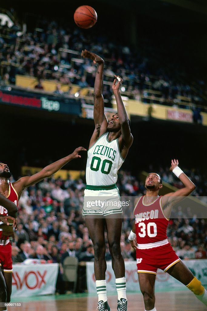 Robert Parish #00 of the Boston Celtics shoots against the Houston Rockets during a game played in 1983 at the Boston Garden in Boston, Massachusetts.