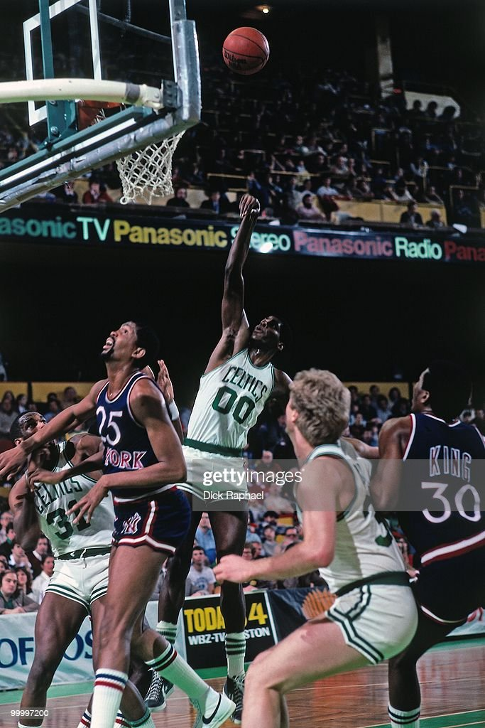 Robert Parish #00 of the Boston Celtics shoots against the New York Knicks during a game played in 1983 at the Boston Garden in Boston, Massachusetts.