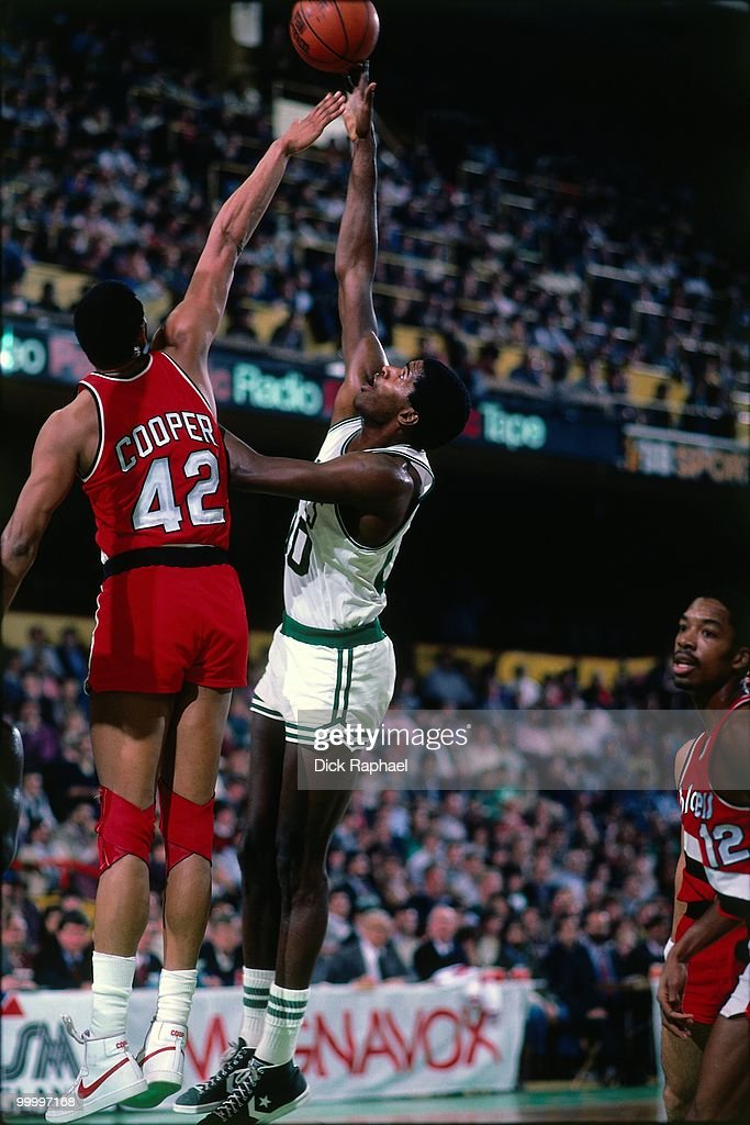 Robert Parish #00 of the Boston Celtics shoots against Wayne Cooper #42 of the Portland Trail Blazers during a game played in 1983 at the Boston Garden in Boston, Massachusetts.