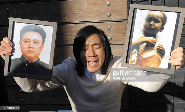 Robert Park holds photos of North Korean leader Kim JongIl and a child suffeing from malnutrition during a protest in front of the Chinese embassy in...