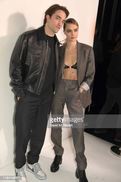Robert Pattinson and Cara Delevingne attend the Dior Homme Menswear Fall/Winter 20202021 show as part of Paris Fashion Week on January 17 2020 in...