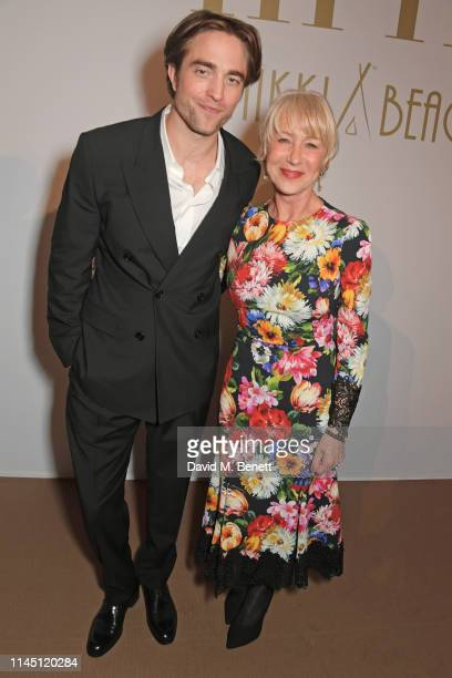 Robert Pattinson and Dame Helen Mirren at Nikki Beach for the HFPA Participant Media event honoring Help Refugees on May 19 2019 in Cannes France