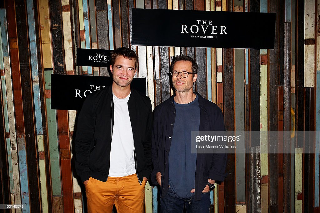 Robert Pattinson and Guy Pearce attend a photo call for 'The Rover' as part of the Sydney Film Festival at Sydney Theatre on June 6, 2014 in Sydney, Australia.