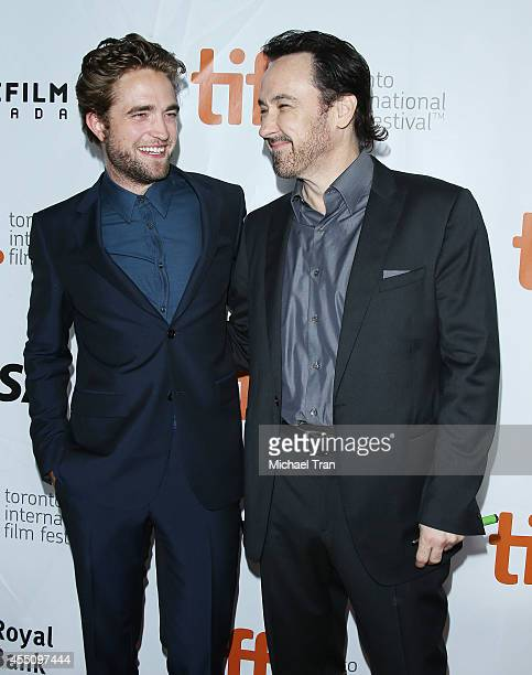 Robert Pattinson and John Cusack arrive at the premiere of Maps Of The Stars held during the 2014 Toronto International Film Festival - Day 6 held on...