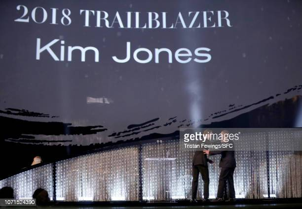 Robert Pattinson and Kim Jones on stage during The Fashion Awards 2018 In Partnership With Swarovski at Royal Albert Hall on December 10 2018 in...
