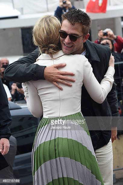 Robert Pattinson and Mia Wasikowska arrive at the 'Palais des Festivals' ahead the 'Maps To The Stars' photocall on day 1 of the 67th Annual Cannes...