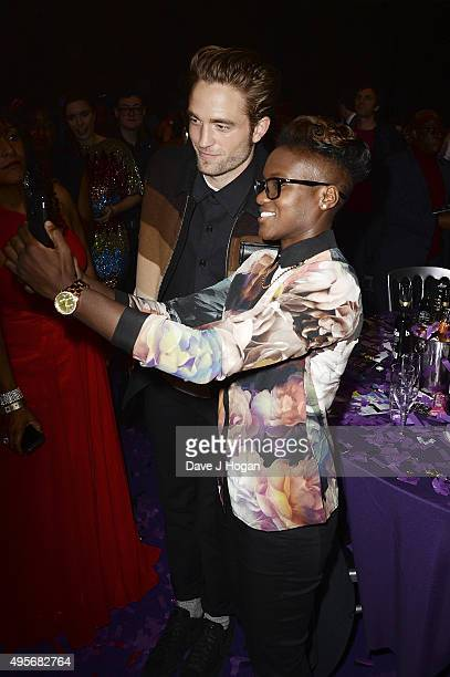 Robert Pattinson and Nicola Adams pose for a photo together during the MOBO Awards at First Direct Arena on November 4, 2015 in Leeds, England.