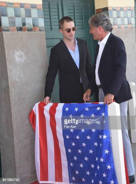Robert Pattinson and Philippe Augier attend Robert Pattinson Photocall the 43rd Deauville American Film Festival at Les Planches de Deauville on...