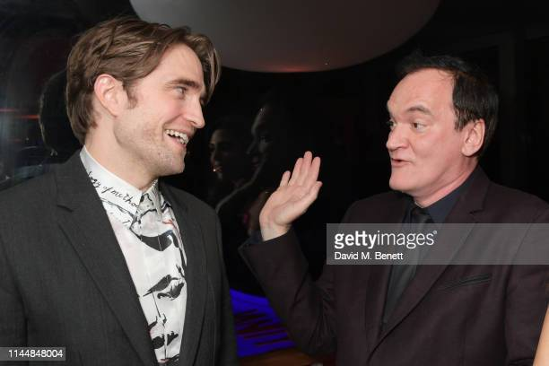 Robert Pattinson and Quentin Tarantino attend the Vanity Fair and Chopard Party celebrating the 72nd Annual Cannes Film Festival at Hotel du...