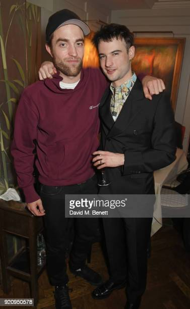 Robert Pattinson and Tom Sturridge attend the LOVE x Miu Miu Women's Tales dinner hosted by Katie Grand and Elle Fanning at Loulou's on February 19...