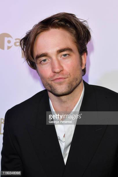 Robert Pattinson attends the HFPA Participant Media Honour Help Refugees' during the 72nd annual Cannes Film Festival on May 19 2019 in Cannes France