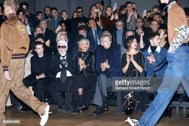 Robert Pattinson Karl Lagerfeld Helene MercierArnault her husband owner of LVMH Luxury Group Bernard Arnault Natasha Andrews and Pierre Niney attend...