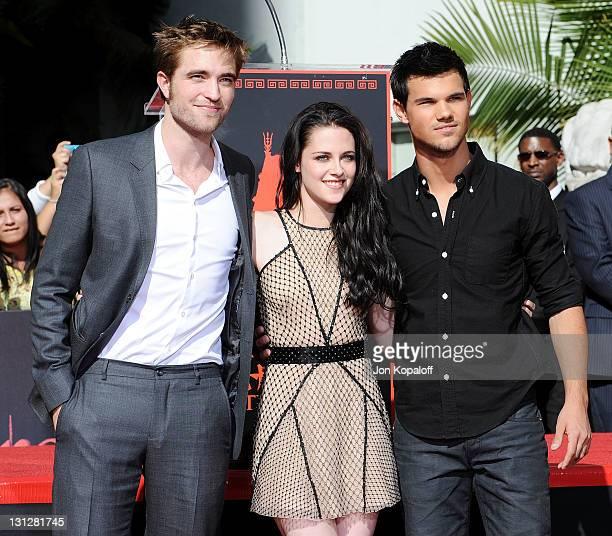 "Robert Pattinson, Kristen Stewart and Taylor Lautner pose at ""The Twilight Trio"" Hand/Foorprint Ceremony at Grauman's Chinese Theatre on November 3,..."