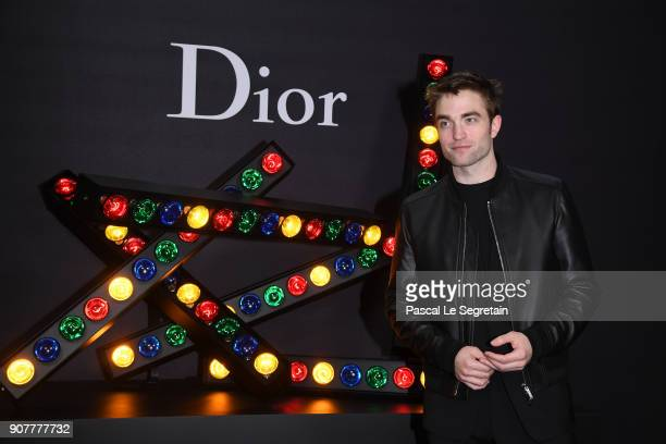 Robert Pattinson poses at Dior Homme Menswear Fall/Winter 20182019 show as part of Paris Fashion Week at Grand Palais on January 20 2018 in Paris...