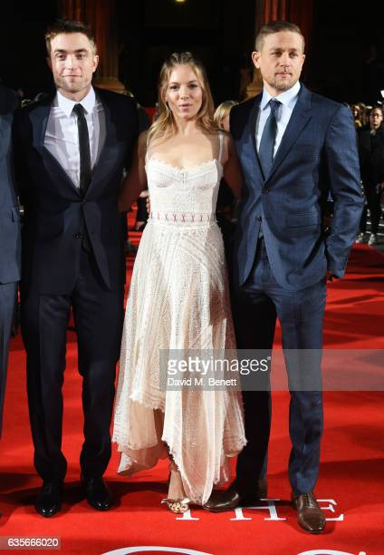 Robert Pattinson Sienna Miller and Charlie Hunnam arrive at The Lost City of Z UK Premiere at The British Museum on February 16 2017 in London United...