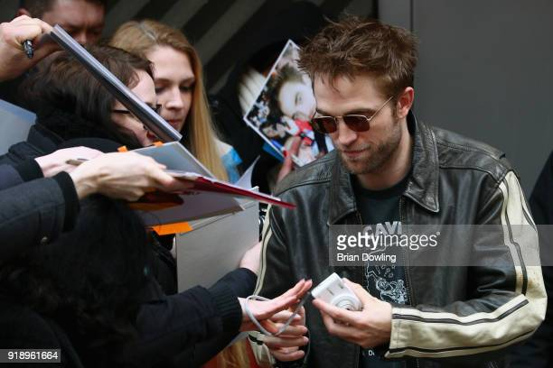 Robert Pattinson signs autographs for fans when arriving for the 'Damsel' photo call during the 68th Berlinale International Film Festival Berlin at...