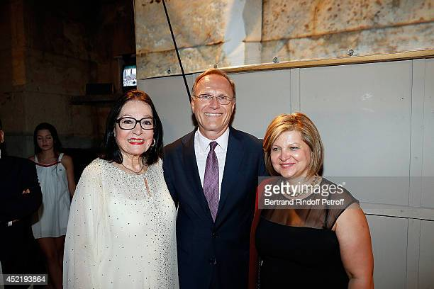 Robert Peck Ambassador of Canada in grece and his wife pose with Nana Mouskouri after the 'Nana Mouskouri Birthday Tour' In Herod Atticus Odeon...